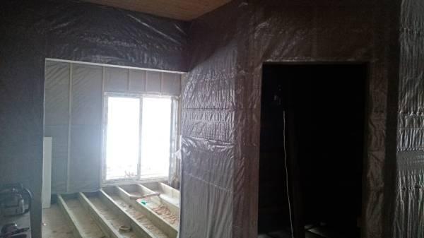 Производятся работы по утеплению каркасного дома